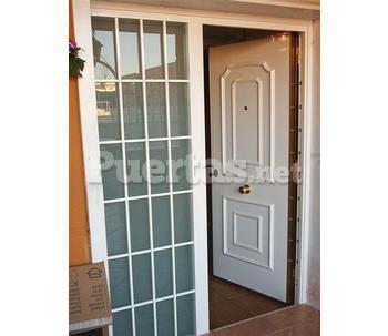 Puertas exteriores vivienda for Cristales para puertas de interior catalogo